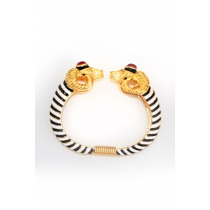 Black and white bangle with gold ram heads