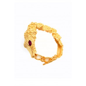 Gold bangle with alligator accent